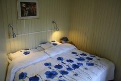 2-persoons bed in de slaapkamer